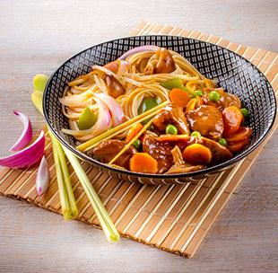 Süß-salziges Schweinefleisch mit Asia-Nudeln Rezept